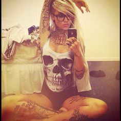 B - Sara Fabel and Black Milk. This swimsuit isn't my favourite; but she makes it look darn good.