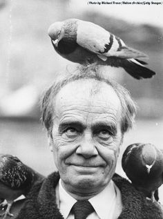Portrait of British comedian Max Wall, with a pigeon on his head in Trafalgar Square, London, 1975