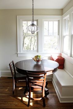 kitchen nook with a gorgeous old table - light above table