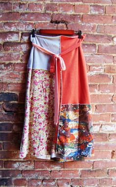 Another Rebirth Recycling Classic.. .the wrap skirt made from recycled/upcycled knit/ t shirt textiles. This wrap can be worn as a skirt or a sundress simply by wrapping around the waist or above the bustline. Due to the flexibility of the knit material,