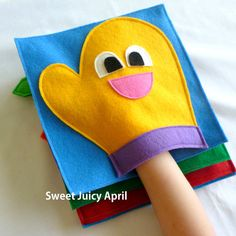 Glove or Mitt Quiet Book Page. Contains a glove/mitt for child to put hand inside of. Can be made in any color scheme. All pages are made of