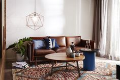 Styling up a brown leather couch with navy and copper