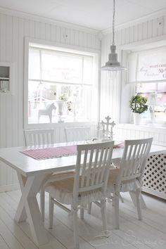 Casual country dining. Love the white with a splash of color and love the natural light.