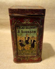 Ancienne boîte tôle lithographiée CACAO 3 SUISSES FAVARGER publicité chocolat.