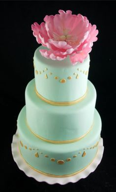Mint and gold simple wedding cake with a pink peony on top.   Jennywennycakes.com
