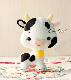 This PDF hand sewing pattern will give you instructions and patterns to make the cute cow and ox pictured. Size: 5 approximately. Language: English THIS IS NOT A FINISHED DOLLS. THIS PDF e-Pattern includes: . Step by step photo tutorial. . A material and supply list. . Full size pattern