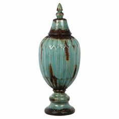 "Add a charming touch of style to your entryway console table or living room mantel with this eye-catching ceramic jar, showcasing a distressed turquoise finish and pedestal silhouette.  Product: Lidded jarConstruction Material: CeramicColor: Distressed turquoiseFeatures: Pedestal silhouetteDimensions: 21.5"" H x 8"" Diameter"