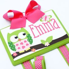 It's durable wood, an adorable owl, can be ordered any color, and will hold all her flower clips. Down fall- not a fan of personalization.
