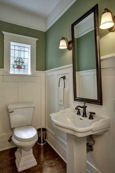 Love the color, walnut mirror placed over paneling, stained glass, etc.
