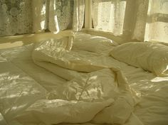 i love this bed... tucked into the corner, bathed in soft sun