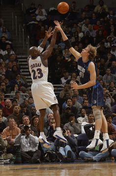 Michael Jordan vs. Dirk Nowitzki. This is one of the few pics of MJ that I will include that acknowledges he was ever in a Washington Uniform.