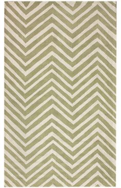 Olive green, zig zag rug for the lounge room - adding some colour and pattern underneath the glass coffee table.