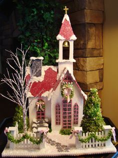 I like these little houses!  Wouldn't it be cute if we could make like a bunch of them and have them be stocking holders as well as building a mantle arrangement!