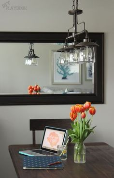 Industrial Light Fixture Over Farmhouse Dining Room Table