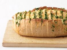 Top an Italian loaf with parsley, garlic, butter and olive oil, then bake until crisp.
