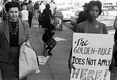 The young woman pictured here is picketing segregated lunch counters at Neisner's McCrory's, F.W. Woolworth's, Walgreen's and Sears stores in Tallahassee, Florida. December 1960.