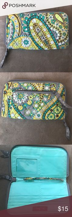 Vera Bradley Wristlet Wallet NWOT Vera Bradley Wristlet Wallet (print is Lemon Parfait I THINK) carried once. Very slender lays flat, and large enough to zip a smartphone into the center and carry like a clutch. Beautiful spring print with turquoise, lime green, vibrant yellow, light grey and white. Inside is a minty turquoise color. Vera Bradley Bags Clutches & Wristlets