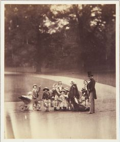 The Royal Collection: The Queen, the Prince and eight Royal Children in Buckingham Palace Garden