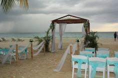 "Walk down the aisle to say ""I DO"" at #couplesweptaway #wedding #beach"
