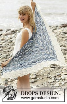 Knitted DROPS shawl with stripes and wave pattern in Fabel. Free pattern by DROPS Design.