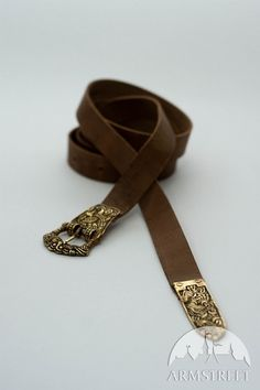 Handmade historically accurate belt with molded accents and clasp  Great quality handmade medieval belt with brass accents. Based on pattern of the