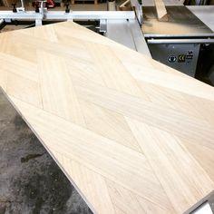"""Table with pattern in oak."