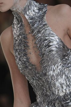 Alexander McQueen Spring 2012. Love the feather-like texture, but would prefer it in gold.
