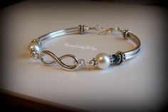 A personal favorite from my Etsy shop https://www.etsy.com/listing/158447461/personalized-infinity-bracelet-infinity