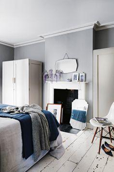 Grey walls/white floors/mirror