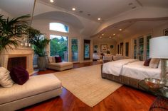 At several thousand square feet, the master bedroom in this newly constructed Bel Air mansion is bigger than many entire homes. It includes a fireplace, sitting area and mini-kitchen facilities, as well as his-and-hers bathrooms and two-story closets.