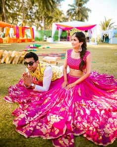 6 Non-Cheesy Ways To Coordinate Bride & Groom Outfits! – UrbanClap Sponsored Sponsored 6 Non-Cheesy Ways To Coordinate Bride & Mehndi Outfit, Pink Lehenga, Bridal Lehenga, Bollywood Lehenga, Saree, Bollywood Style, Bridal Mehndi, Wedding Wear, Wedding Couples