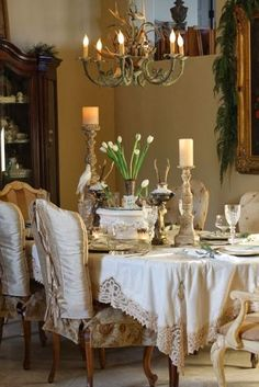 love the chair back covers and the tablecloth.  Look at that lace..