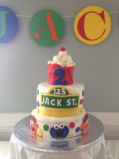 Jack's 2nd birthday Sesame Street cake! Buttercream frosting, fondant characters, red velvet cake and chocolate filling