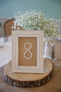 Pearl wedding table numbers in burlap backed frames   A DIY Wedding at The Landmark Resort in Egg Harbor, Wisconsin (Featured on The Knot)   Photo by Jason Mann Photography 920-246-8106   http://www.JMannPhoto.com