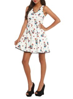 Ivory dress with an Ariel nautical tattoo print, button accents, black lace trim and side zipper closure.