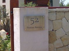 Stainless Steel Sign, Grade 304 with brushed finish and mounted with Mounting Spacers.