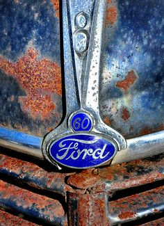 rust on the hood and grill of a Ford!