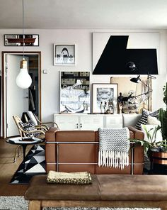 The Ikea PS metal cabinets fit seamlessly into a home filled with designer pieces and art. Image from ELLE Decoration UK via sfgirlbybay.