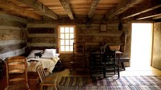 love this rustic log house interior. The stick chair is from Northern Ireland but I guess the cabin is America