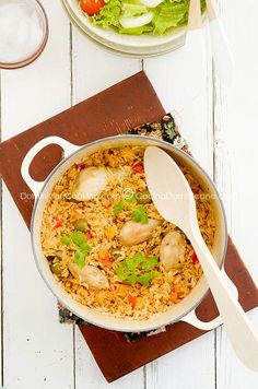 Dominican Style Rice & Chicken, loaded with Vegetables and Flavors.