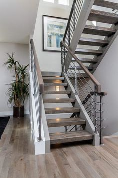 Custom floating stair case with hardwood treads and a metal rail.  What a dramatic way to make a statement.  Built by Denver Design Build in the LoHi area of the Denver Highlands. www.DenverBuild.com Jay Feaster