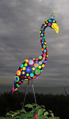 Button Flamingo - handmade, garden art sculpture created from a recycled pink plastic flamingo.