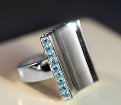 Citations NYC's Swiss Blue Topaz, borders a Concave, High-Polished Sterling Silver Ring, on Sale!