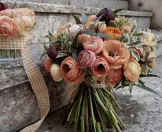 What type of flowers are these? #flowers It looks to me that the main flowers are peonies, ranunculus, and anemones!