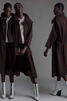 Vintage Issey Miyake Coat, Maison Martin Margiela Sweater and Yves Saint Lauren Velvet Skirt. Designer Clothing Dark Minimal Street Style Fashion Black Model