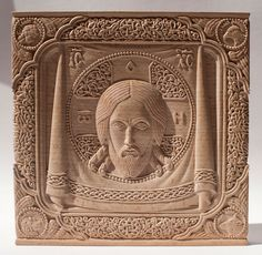 """Carved icon """"Mandylion"""", beech wood before covering with oil varnish. Artists are Elena and Sergio Nikolenko"""