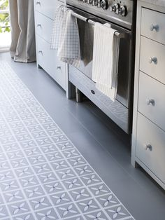 Create a pure and simple interior space filled with fresh blue hues seen in these geometric vinyl floor tiles - Dee Hardwicke Lattice Pebble Grey flooring from Harvey Maria.  http://www.harveymaria.co.uk/Floor-Range/dee-hardwicke-for-harveymaria/lattice-pebble-grey