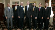 Randy Quarles, third from the right, poses with John Snow and other members of Snow's senior staff at the Treasury Department Monday on Aug. 8, 2005.