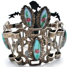 Handmade Jewelry Set - This is a sterling silver bracelet and screwback earring set with french venetian art glass pink and blue rose links. All pieces are hallmarked Silver Mexico. The bracelet is 7.