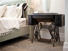 By mixing old and new styles, you can keep your bedroom from looking stale and instead make it look all your own. Here, a unique nightstand with a Singer base makes a statement against a gorgeous herringbone-patterned floor and mint bed.
